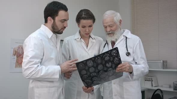 Thumbnail for Group of Doctors Checking an MR Exposure