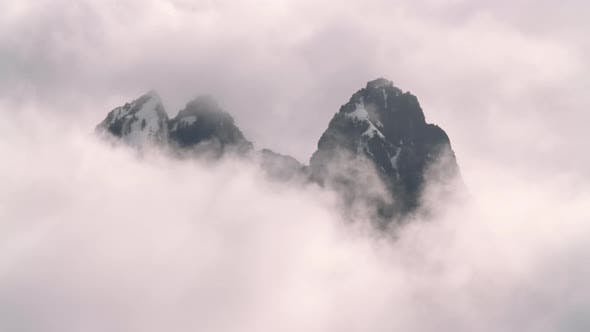Thumbnail for Breathtaking Rolling Clouds Timelapse Of Majestic Peak