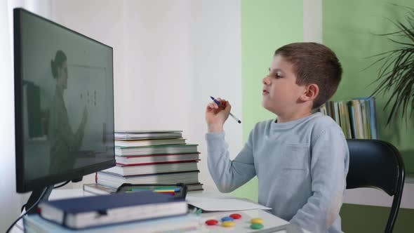 Video Broadcast of Lesson, Boy Schoolboy Teaches Mathematics By Video Link with Teacher Using Modern