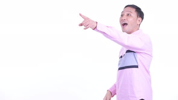 Thumbnail for Profile View of Happy Japanese Businessman Pointing Finger