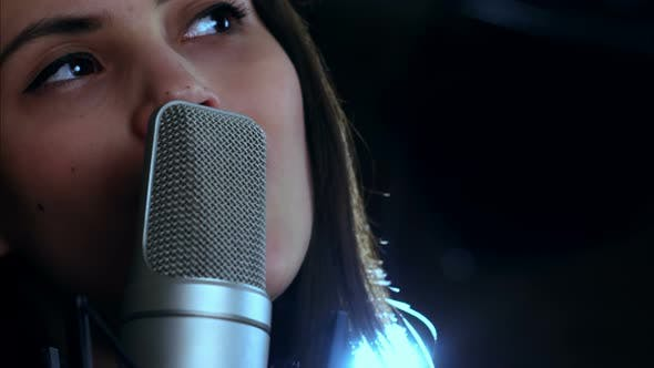 Young Pretty Woman Singing