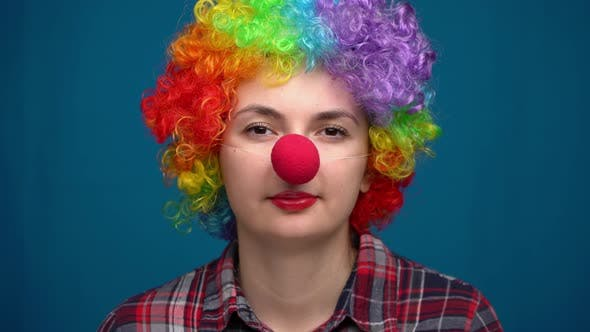 Portrait of a Clown on a Blue Background