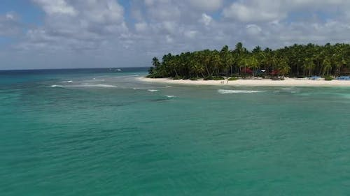 Drone is Flying Over the Ocean and a Tropical Beach with Palm Trees Vacation