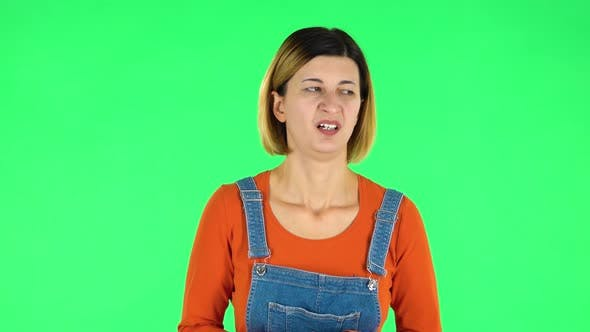 Cover Image for Woman Showing Disgust for Bad Smell or Taste. Green Screen