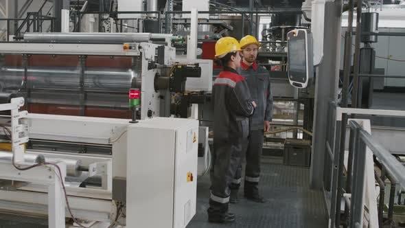 Engineers At Industrial Factory