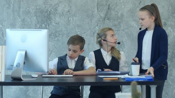 Thumbnail for Little boy and cute girl in business suits working in the