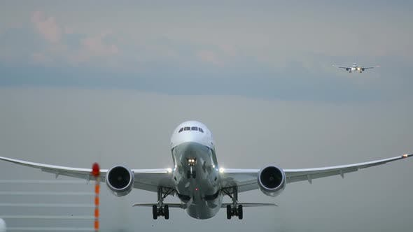 Thumbnail for Twin Engine Widebody Airplane Take Off in the Morning