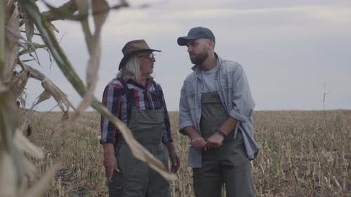 Senior Farmer Sharing Wisdom with Grandson