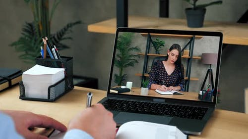 Businessman and businesswoman managers at home office work together online video call chat laptop