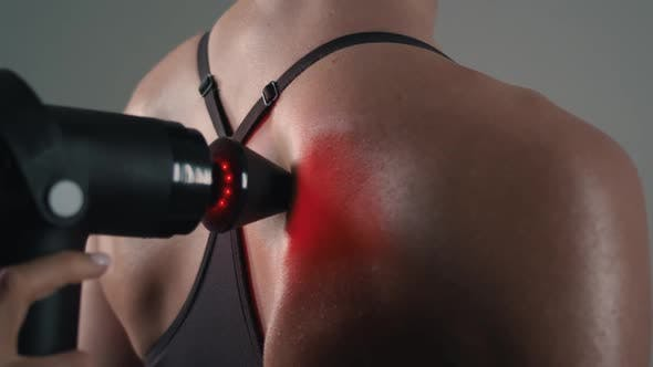 Thumbnail for Girl Uses a Massager on Her Back Close-up