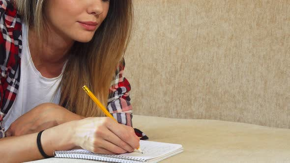 Thumbnail for The Young Girl Is Writing in Her Notebook