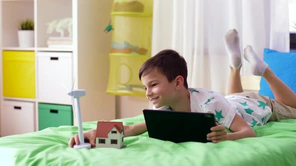 Thumbnail for Boy with Tablet Pc and Wind Turbine Toy at Home 14