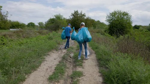 Eco Activists Volunteers Clean Up Garbage In The Nature