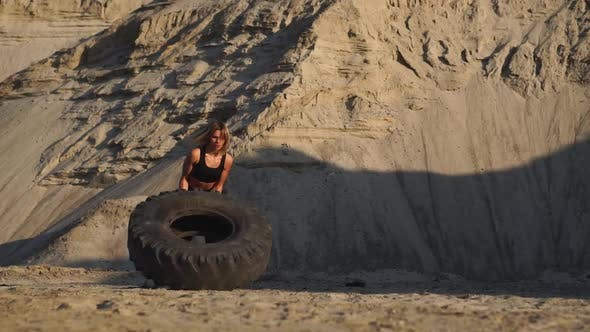 Thumbnail for Girl on Sand Quarry Pushing Wheel in Training Crossfit Workout