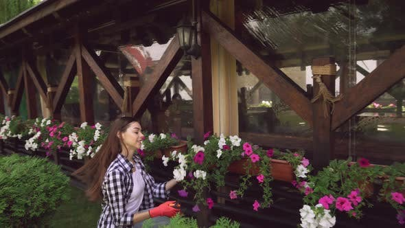 Thumbnail for Girl in Rubber Gloves Cutting Plants with Garden Pruner