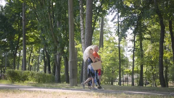 Thumbnail for Happy Mature Couple Walking in the Park Together