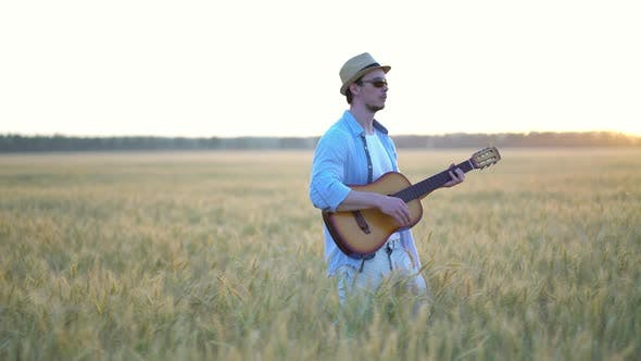Thumbnail for Playing Acoustic Guitar Outdoors in Wheat Fields