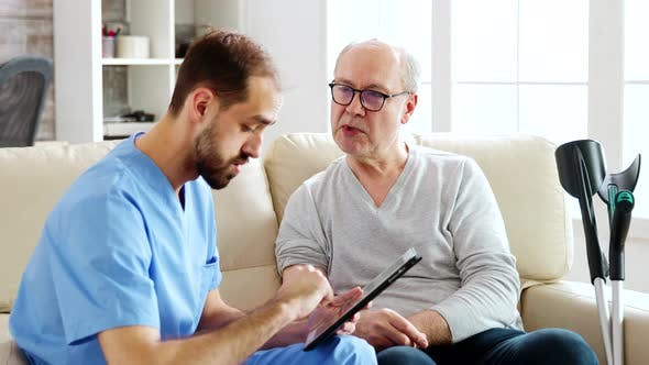 Thumbnail for Caucasian Male Nurse Talking with a Nursing Home Patient About His Health
