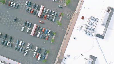 Air top view on of the parking lot on shopping mall the are cars on parking