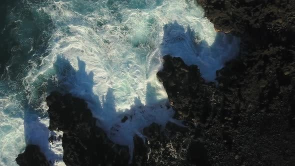 Thumbnail for Aerial Of Waves Crashing In To The Shore