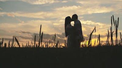 Kissing At Sunset