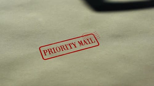 Priority Mail Seal Stamped on Blank Paper Background, Fast Delivery Service