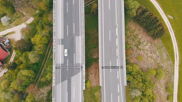 Cover Image for Aerial Top View of Highway Viaduct with Multilane Traffic in Mountains. Autobahn in Austria