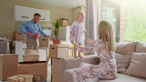 Thumbnail for Happy Family Packing Boxes in Room. Moving Concept