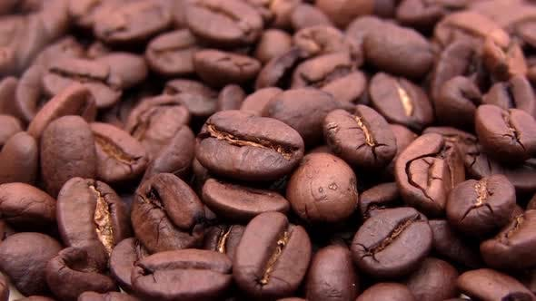 Cover Image for Roasted Coffee Beans Brown Color Lies on a Table