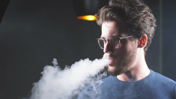 Thumbnail for Guy with Smoke From His Mouth Thinking About Something