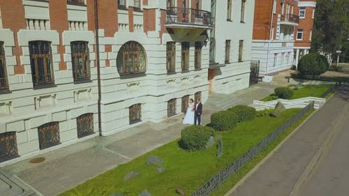 Just Married Couple Walks Past Restored Building Upper View