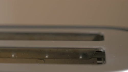 Toasting bread in electric toaster 4K 2160p UltraHD footage - Toast bread in double electric toaster