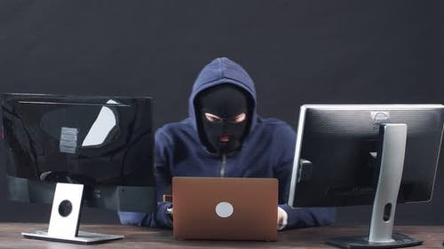Serious Hacker Male Isolated in Dark Space