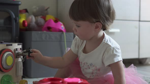 Thumbnail for Cute Baby Girl Playing with Toy at Home