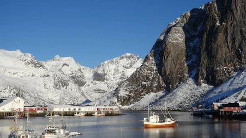 Norwegian Winter Landscape With The Multicolored Rorbu And Fishing Ships 38