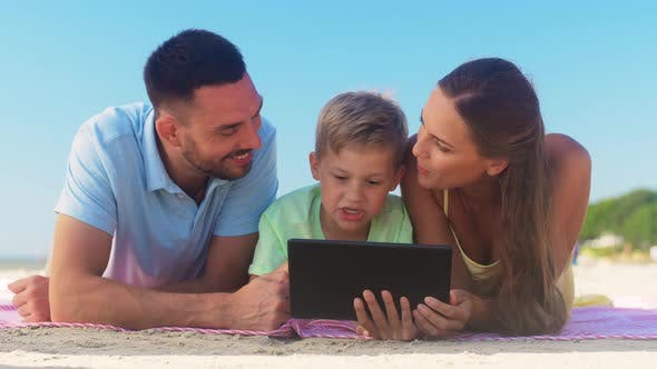 Thumbnail for Happy Family with Tablet Computer on Summer Beach