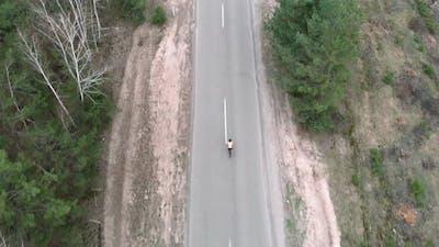 Cyclist biking on bicycle