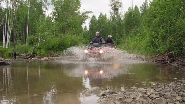 Thumbnail for People Driving Quad Bikes through Water