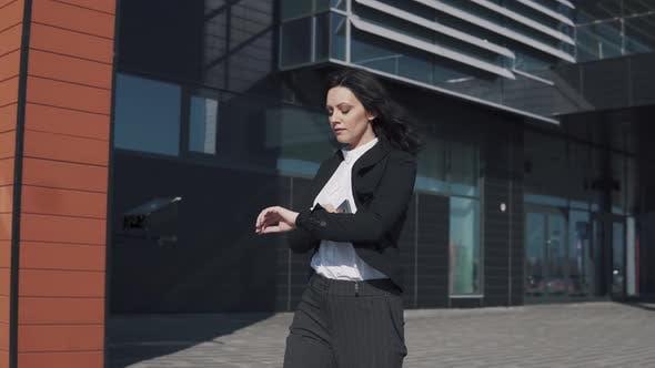 Thumbnail for Business Woman Walks Past a Modern Business Center