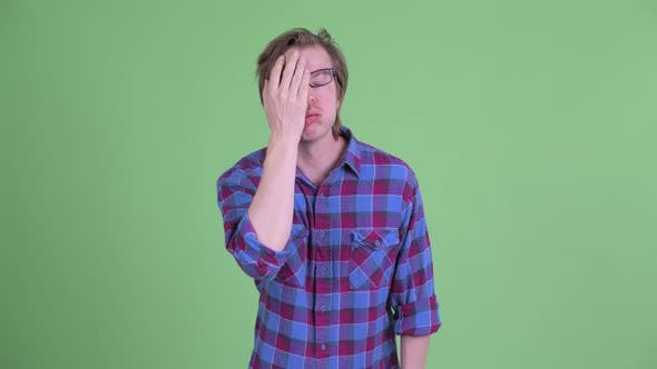 Cover Image for Stressed Young Hipster Man with Face Palm Gesture