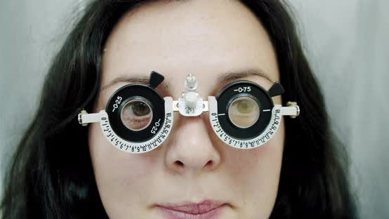 Thumbnail for Close Up Eyesight Measurement To Young Woman with Optical Phoropter. Woman Doing Eye Test Slow