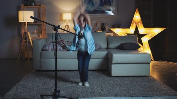 Thumbnail for Little Girl Child Singing Song Into Microphone At Home