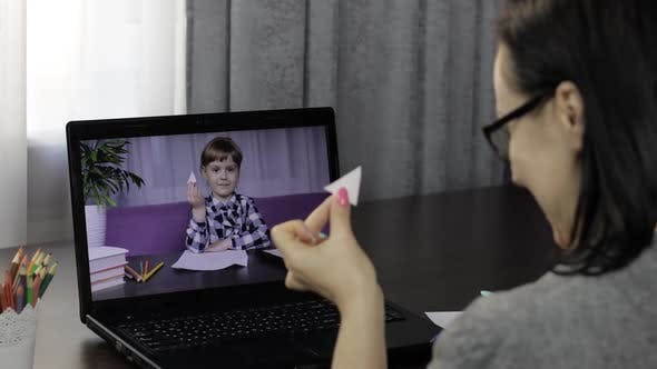 Thumbnail for Teacher Making Video Call on Laptop with Pupil. Distance Children Education