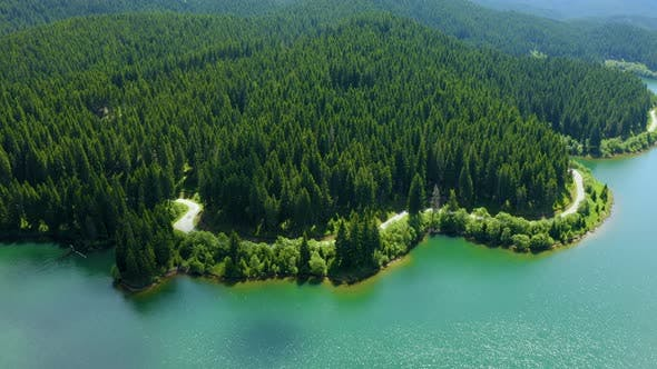 Thumbnail for Aerial view over beautiful mountain road with turquoise lake and green forest. Baikal Lake Siberia
