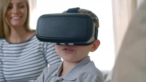 Thumbnail for Mother Watching Son Experiencing Virtual Reality
