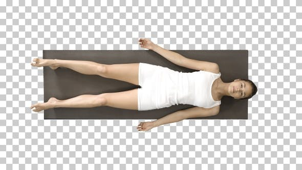 Yoga meditation laying on a mat with closed eyes, Alpha Channel