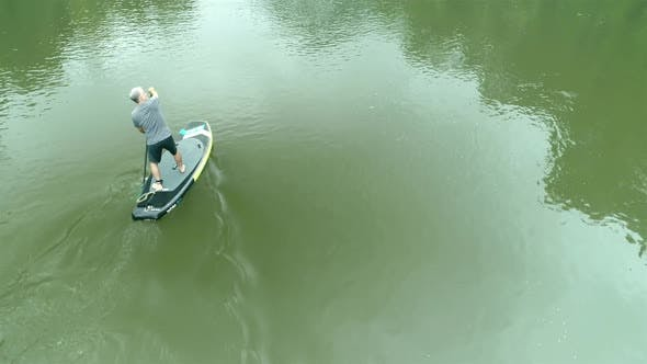 Paddle Boarder On Jungle River