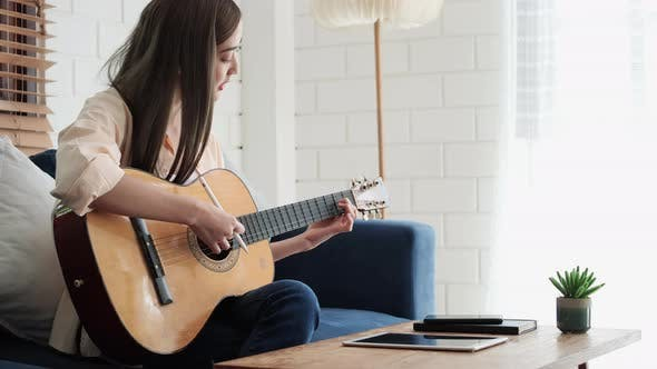 Playing guitar and compose music