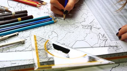 Woman Architect Working and Drawing