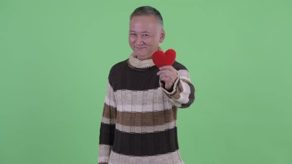 Thumbnail for Happy Mature Japanese Man Giving Red Heart